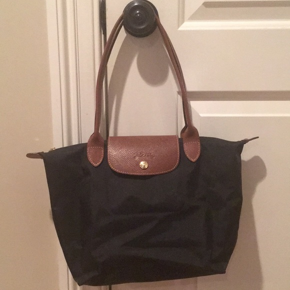 8bce0544d Longchamp black and brown small tote. Longchamp.  M_5a69e973caab44d6186990c9. M_5a69e97c2c705d0f17431677.  M_5a69e98cb7f72b60c46e64ef